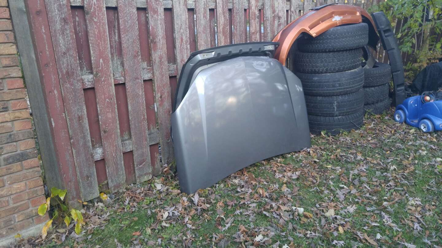 Photo Chevy equinox front hood and back tailgate in fair condition. Fits For a 2005 -09 . the color is. Darkish gray .