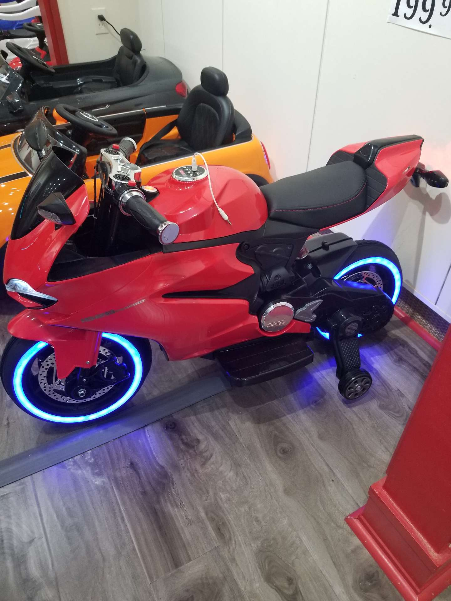 Photo Tron motorcycle and BMW series 4 coupe.
