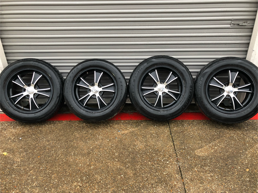 """Photo 17"""" American Racing black machined rims with tires"""