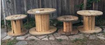 Photo WOOD SPOOL PATIO TABLE WITH UMBRELLA HOLDER - $15