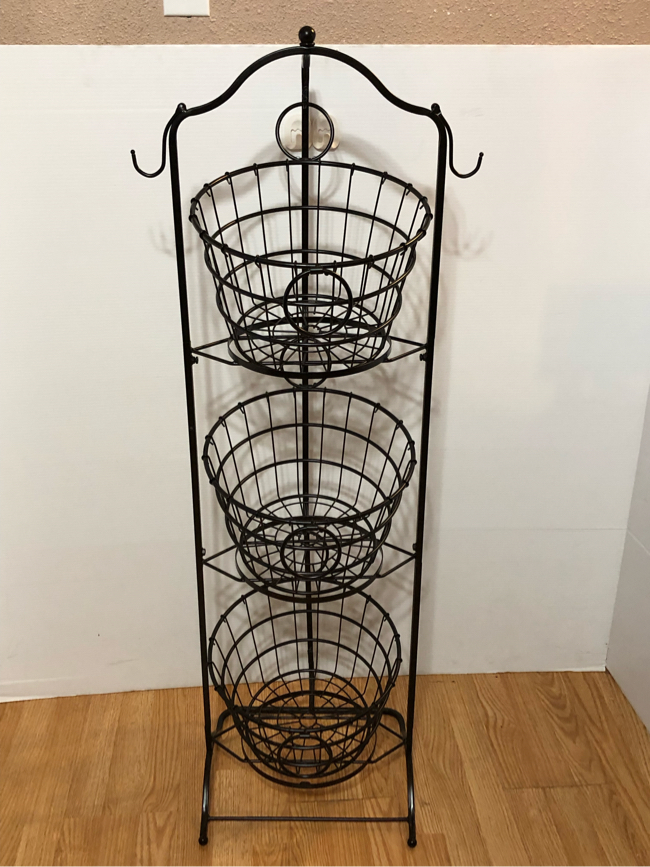 Photo 3-TIER WIRE BASKET WITH METAL STAND.