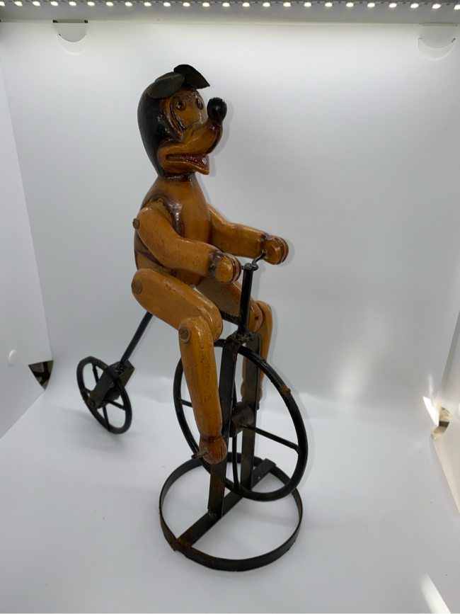 Photo Antique 1900d Mickey Mouse on Bike Legs move if pedals or wheel turned. Hand made Wood Carved. On metal bike. Very unique and very well built. 13  TALL, 9 WIDE, 5 DEEP $300