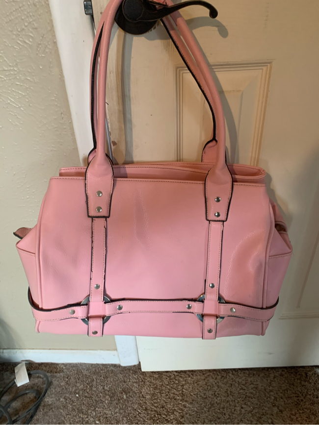 Photo Pink and black leather purse