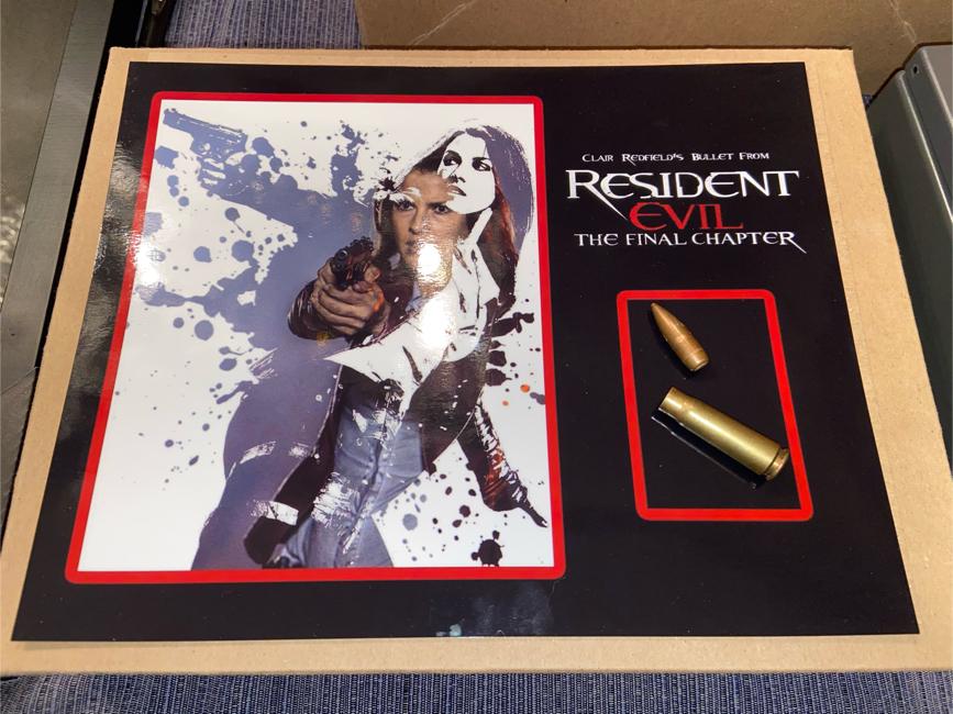 Photo MOVIE PROP Resident Evil: Final Chapter (Ali Larter) Screen Used Bullet w/ Custom Photo
