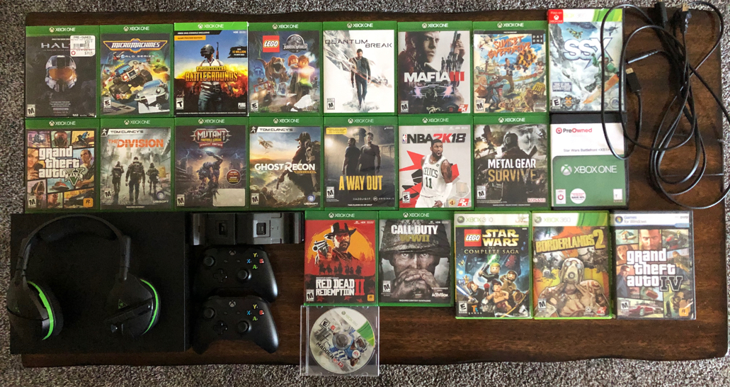 Photo Xbox One X with 22 games, 2 controllers, Turtle Beach Headset, Charging base with 2 rechargeable batteries.