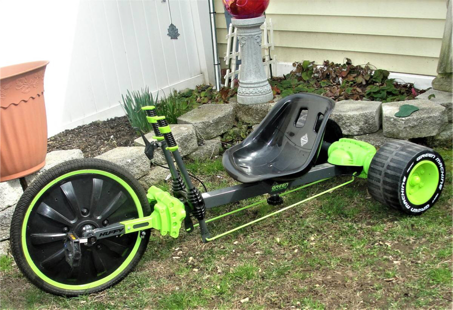 Photo Huffy Green Machine 20 in. Trike Black and Green .. very good used condition. Bristol Boro, Pa. 19007 Let your kids experience the ultimate thrill ride with the Huffy Green Machine. It features dual stick steering, a steel frame, and rubber front tire. I
