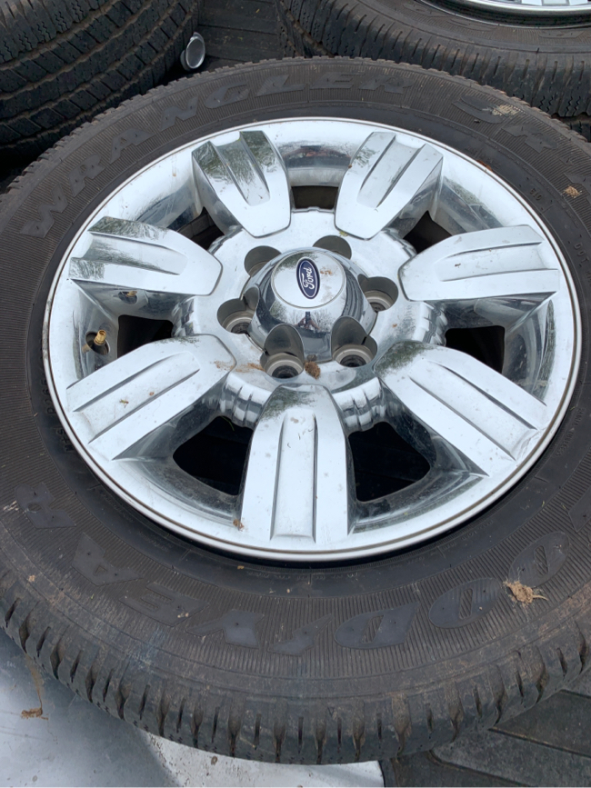 Photo Hello I have a set of stock wheels off a 2012 f150 with Goodyear wranglers 60% tread left let me know if your interested