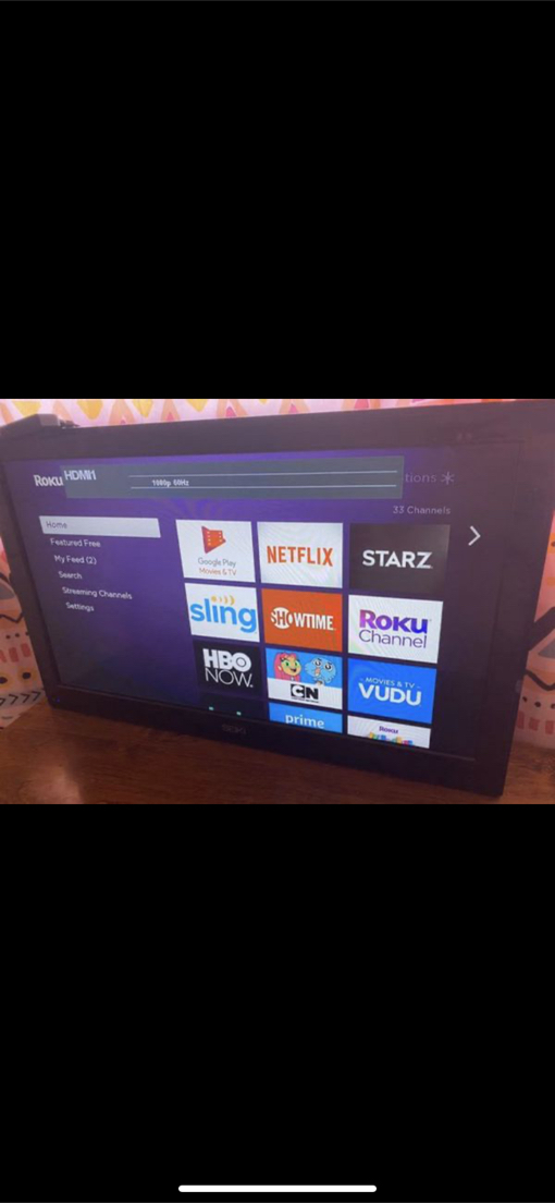 Photo 32 Inch Seiki TV with Roku Included
