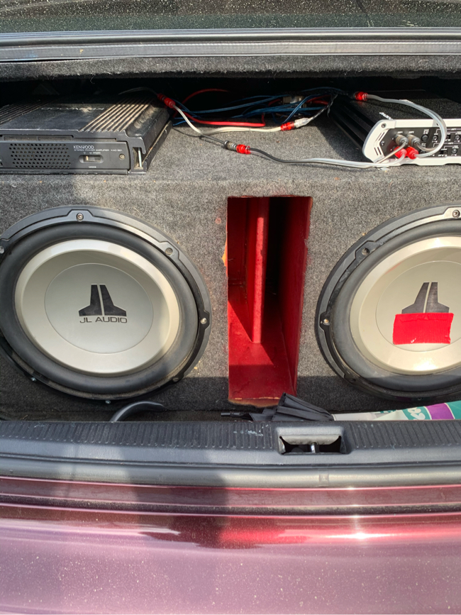 Photo 2 JL audio subs with box 500 watt kenwood amp 400 watt kicker amp