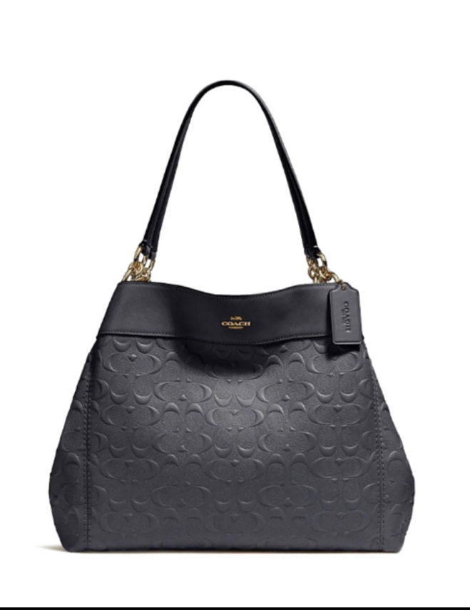 Photo Coach Lexy Shoulder Bag In Signature Leather Midnight Blue F25954 Condition: Like new. Only used twice for a photo shoot. Sell for almost $300 in the Coach store. Selling for $125. Makes for a great birthday gift or present for the woman in your life
