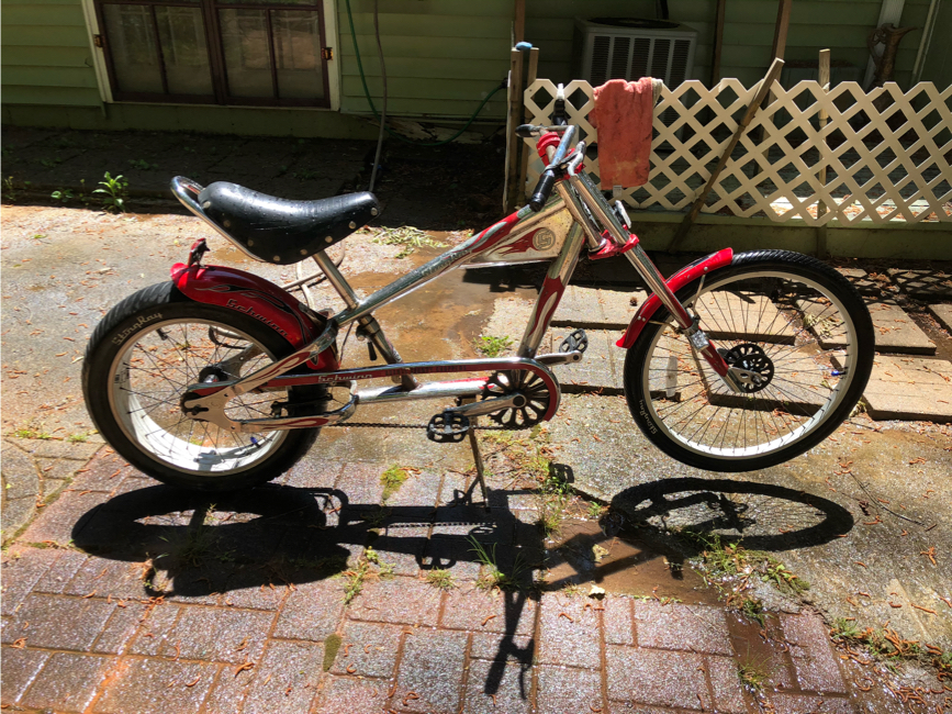 Photo CHOPPER bike has a little rust can be restored back I am to old to finish it new ones go for 750 dollars