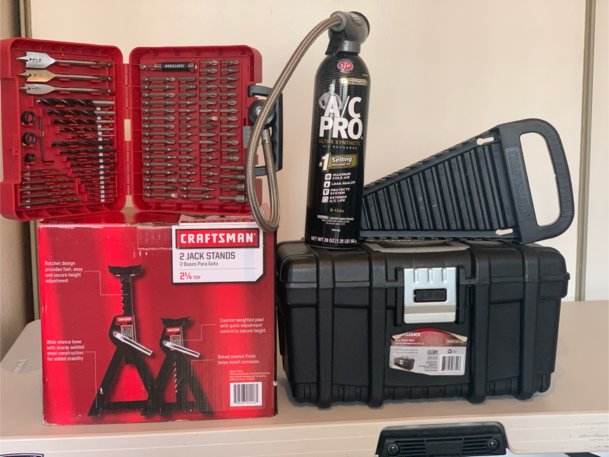 "Photo AC/Recharge kit., Husky 16"" tool box., Craftsman 100 PC Drill bit kit, organizer wrench, 2-1/4 Ton Jack Stand"