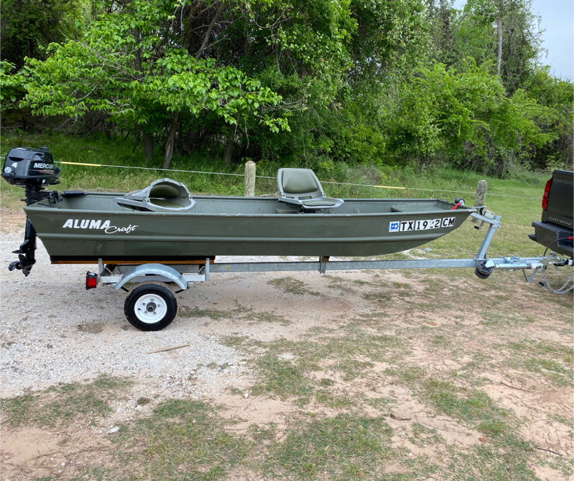 Photo 12ft Jon Boat with Mercury outboard and trailer