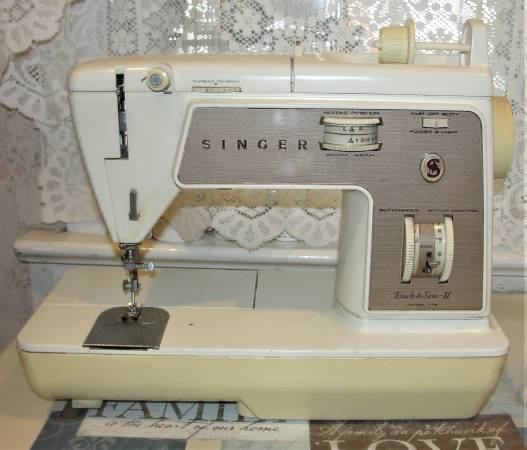 Photo Vintage Singer Touch & Sew II Portable Sewing Machine #778 with Hard Carry Case. It is clean and works.. see photos there is a flap to fold down making it easy to sew sleeves or pant bottoms. Use this to make masks and get your money back in no time. Bri